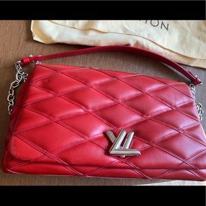 Red quilted Louis Vuitton handbag